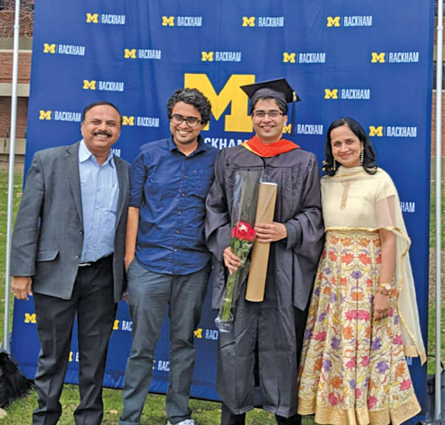 Family picture with younger son Aditya holding his degree